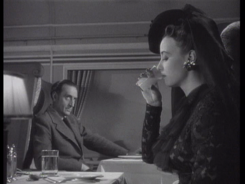 Basil Rathbone and Renee Godfrey in Terror by Night (1946)